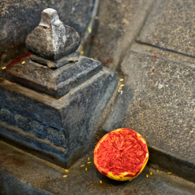 Sliced lemon with kumkum placed by the kalasam of east arch.