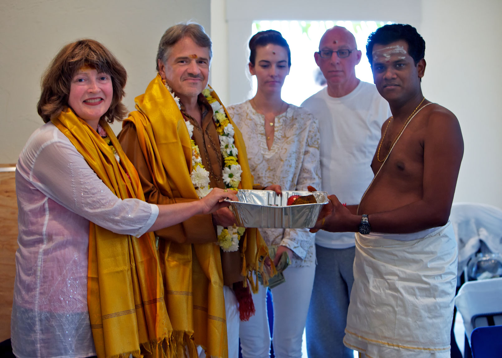Sthapati SK accepts dakshina offered in gratitude.